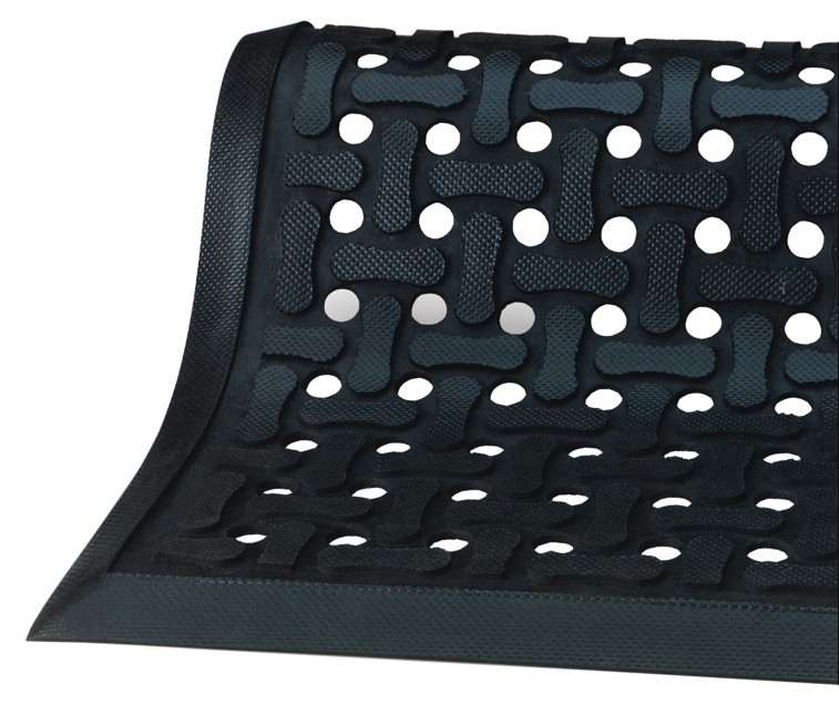 An anti-fatigue mat with scraping capabilities