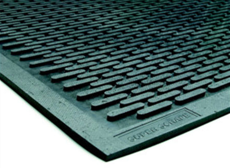 An upclose image of an outside scraper floor mat