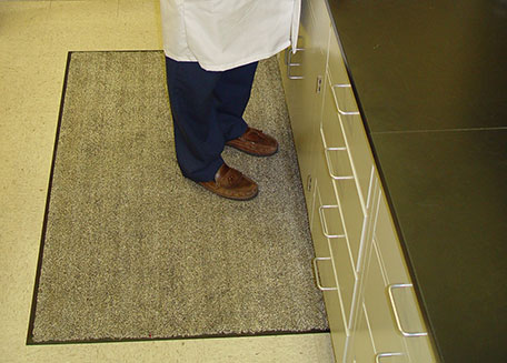 Cotton floor mat placed on a lab floor